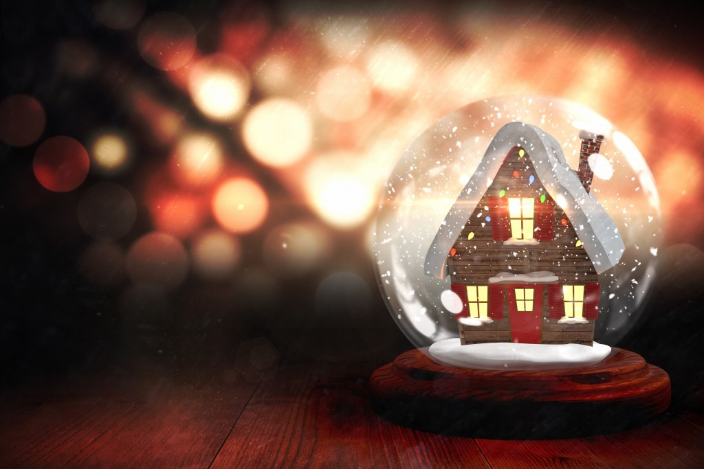 Christmas house in snow globe